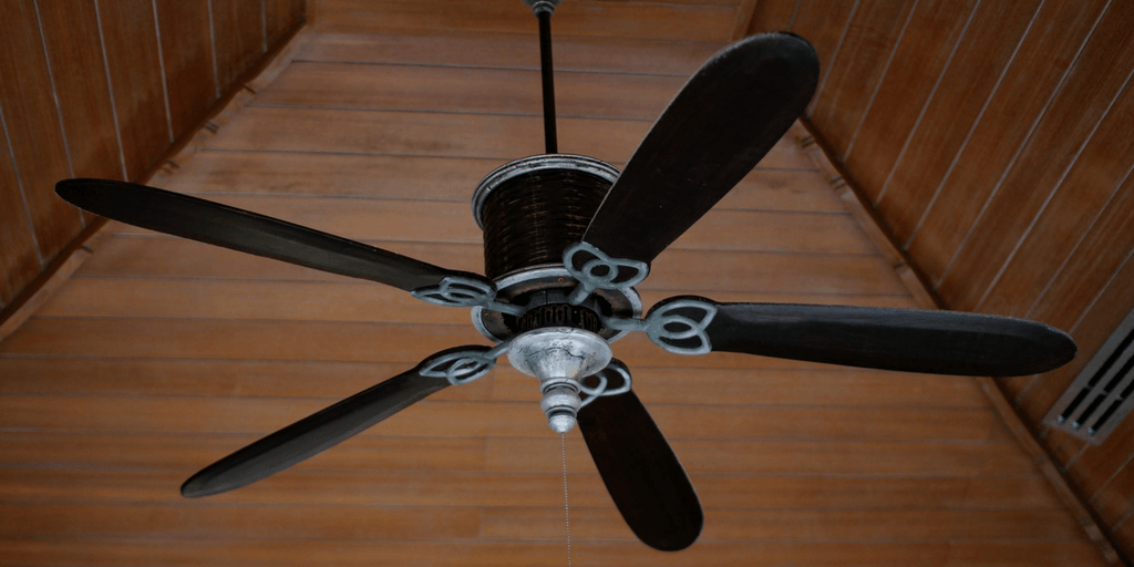 ceiling fan hanging from a wood ceiling