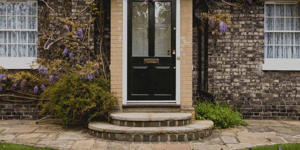 the front door of a brick house