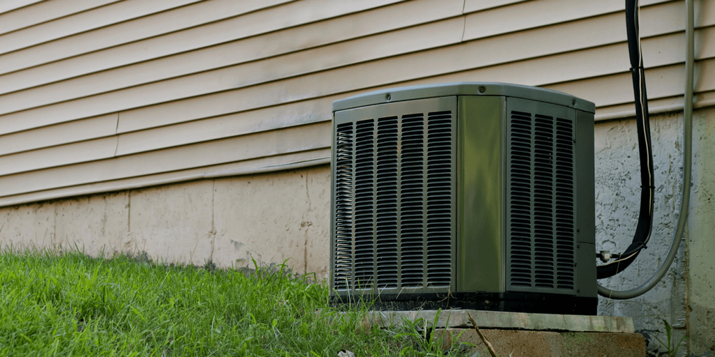 outdoor air conditioning unit along the exterior wall of a house