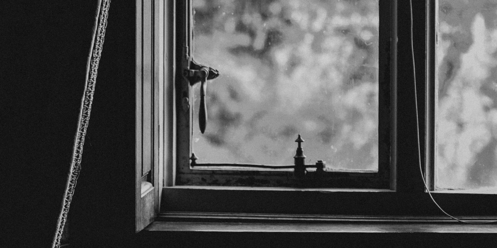 black and white picture of the bottom corner of a window